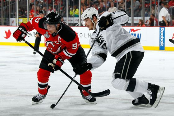 Dustin Brown #23 of the Los Angeles Kings skates with the puck against Zach Parise #9 of the New Jersey Devils during Game Five of the 2012 NHL Stanley Cup Final at the Prudential Center on June 9, 2012 in Newark, New Jersey.