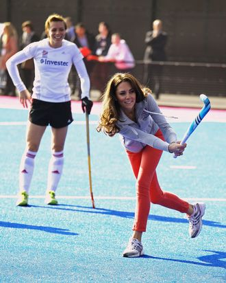 Women's Team GB hockey captain Kate Walsh watches Catherine, Duchess of Cambridge play hockey with the GB hockey teams at the Riverside Arena in the Olympic Park on March 15, 2012 in London, England. The Duchess of Cambridge viewed the Olympic park as well as meeting members of the men's and women's GB Hockey teams.