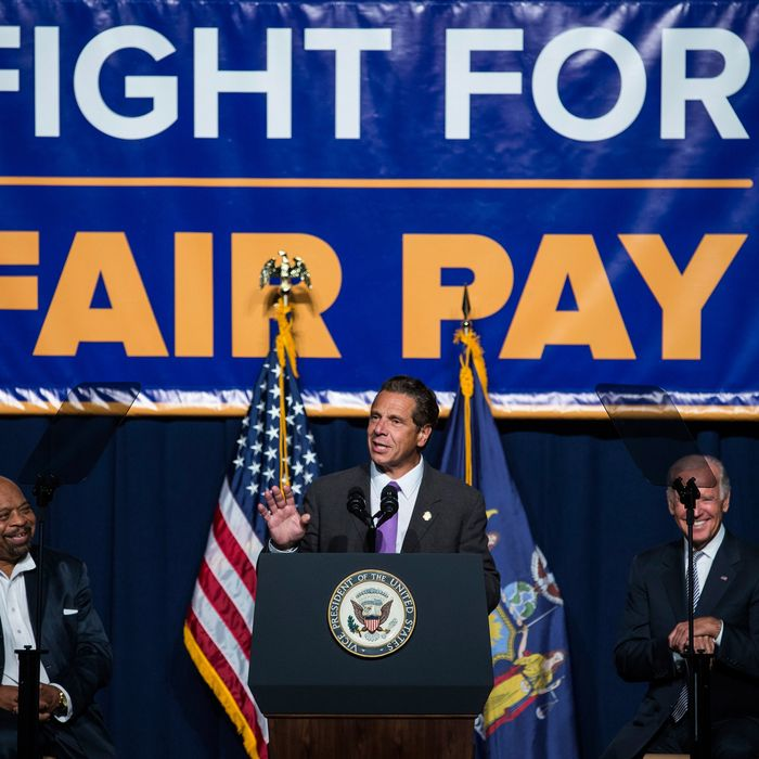 Cuomo announcing his support for a $15 minimum wage last September.