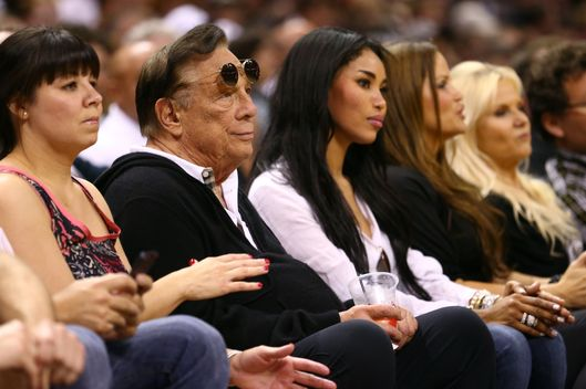 SAN ANTONIO, TX - MAY 19:  (2nd L) Team owner Donald Sterling of the Los Angeles Clippers watches the San Antonio Spurs play against the Memphis Grizzlies during Game One of the Western Conference Finals of the 2013 NBA Playoffs at AT&T Center on May 19, 2013 in San Antonio, Texas.  NOTE TO USER: User expressly acknowledges and agrees that, by downloading and or using this photograph, User is consenting to the terms and conditions of the Getty Images License Agreement.  (Photo by Ronald Martinez/Getty Images) *** Local Caption *** Donald Sterling