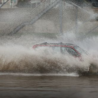 CHICAGO, IL - APRIL 18: A motorist drives through a flooded section of the Kennedy Expressway on April 18, 2013 in Chicago, Illinois. Thunderstorms dumped up to 5 inches of rain on parts of the Chicago area overnight, closing sections the Edens, Eisenhower and Kennedy expressways, which lead to and from downtown, during the morning rush. (Photo by Scott Olson/Getty Images)