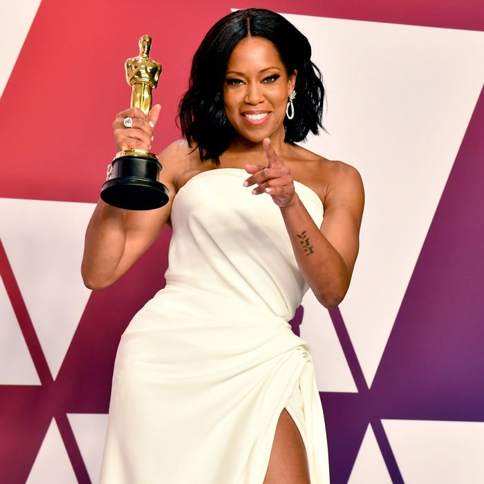 Regina King with her first Oscar.