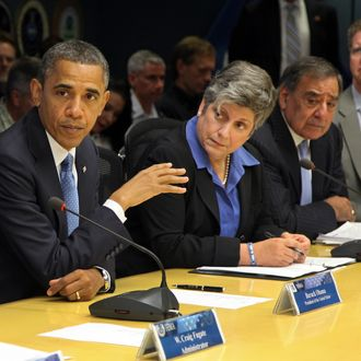 WASINGTON, DC - OCTOBER 31: U.S. President Barack Obama (L) speaks as Homeland Security Secretary Janet Napolitano (2nd L), U.S. Defense Secretary Leon Panetta (2nd R) and Housing and Housing and Urban Development Secretary Shaun Donovan.listen at FEMA headquarters abolut cleanup efforts in the wake of Hurricane Sandy Oct.ober 31, 2012 in in Washington, DC. Obama will be touring parts of storm ravavaged New Jersey later in the day. (Photo by Martin H. Simon-Pool/Getty Images)