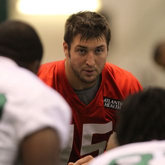Quarterback Tim Tebow #15 of the New York Jets participates in Organized Team Activities on May 24, 2012 in Florham Park, New Jersey.