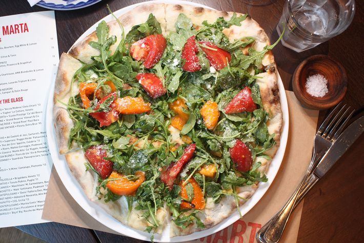 Pomodoro Fresco: arugula salad, buffalo mozzarella, and heirloom tomatoes.