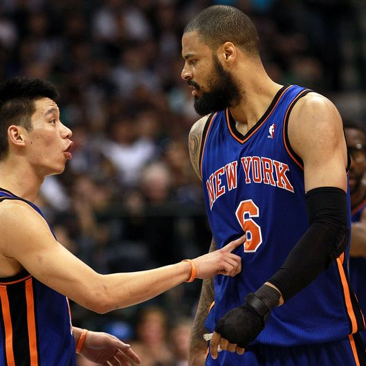 Jeremy Lin #17 of the New York Knicks talks with Tyson Chandler #6 during play against the Dallas Mavericks at American Airlines Center