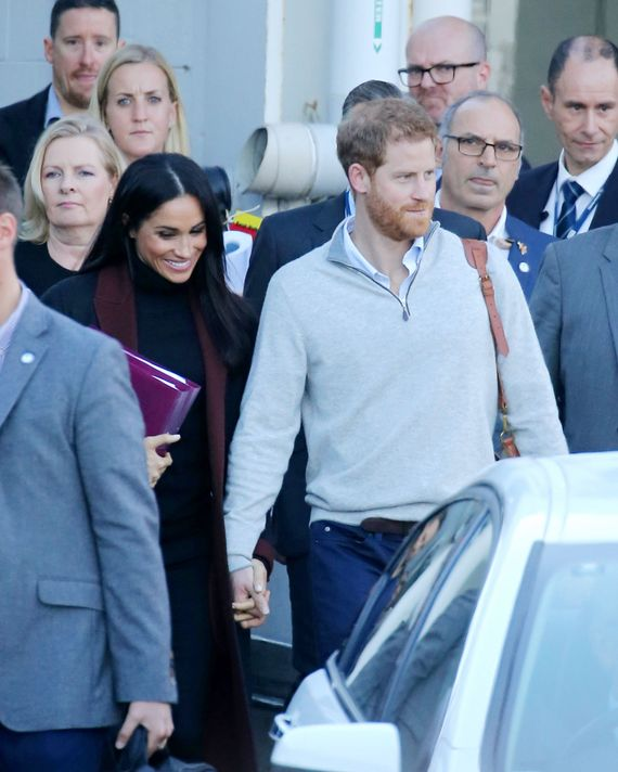 Meghan Markle and Prince Harry holding hands.