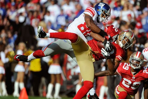 Carlos Rogers #22 of the San Francisco 49ers intercepts the pass in front of Victor Cruz #80 of the New York Giants during an NFL football game at Candlestick Park November 13, 2011 in San Francisco, California. The 49ers won the game 27-20.