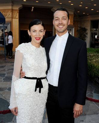 Actress Liberty Ross (L) and her husband director Rupert Sanders arrive at a screening of Universal Pictures'