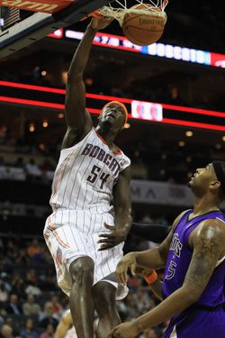 CHARLOTTE, NC - FEBRUARY 25:  DeMarcus Cousins #15 of the Sacramento Kings watches as Kwame Brown #54 of the Charlotte Bobcats dunks the ball during their game at Time Warner Cable Arena on February 25, 2011 in Charlotte, North Carolina. NOTE TO USER: User expressly acknowledges and agrees that, by downloading and/or using this Photograph, User is consenting to the terms and conditions of the Getty Images License Agreement.  (Photo by Streeter Lecka/Getty Images)