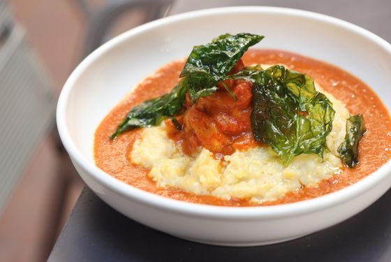 Crawfish etouffee with buttermilk grits and crispy spinach.