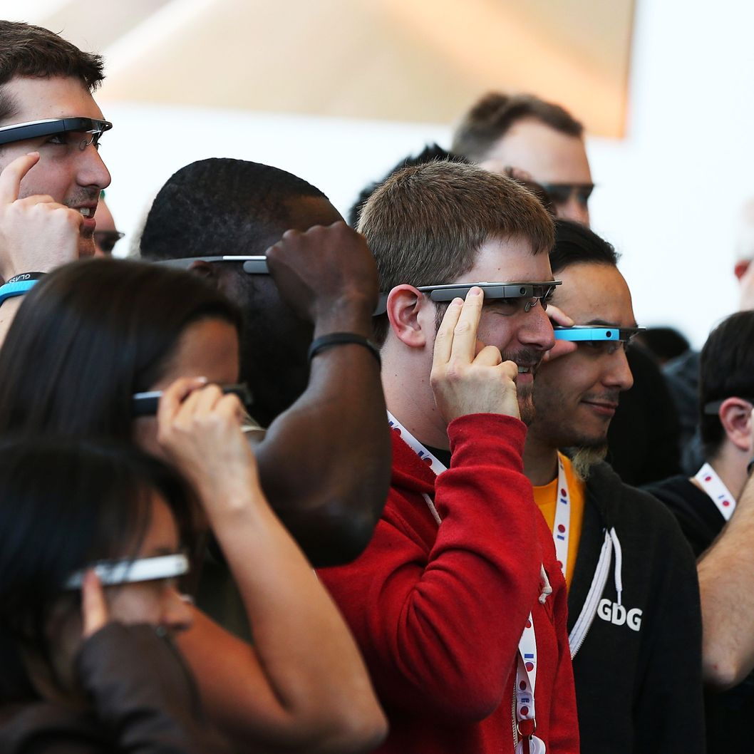 "Attendees wear Google Glass while posing for a group photo during the Google I/O developer conference on May 17, 2013 in San Francisco, California. Eight members of the Congressional Bi-Partisan Privacy Caucus sent a letter to Google co-founder and CEO Larry Page seeking answers to privacy questions and concerns surrounding Google's   photo and video-equipped glasses called ""Google Glass"".  The panel wants to know if the high tech eyeware could infringe on the privacy of Americans. Google has been asked to respond to a series of questions by June 14."