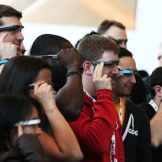 Attendees wear Google Glass while posing for a group photo during the Google I/O developer conference on May 17, 2013 in San Francisco, California. Eight members of the Congressional Bi-Partisan Privacy Caucus sent a letter to Google co-founder and CEO Larry Page seeking answers to privacy questions and concerns surrounding Google's photo and video-equipped glasses called