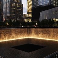 NEW YORK, NY - MAY 30: The 9/11 Memorial is viewed during a ceremony for recovery workers and first responders on the10-year anniversary of the formal end of cleanup operations at Ground Zero on May 30, 2012 in New York City. Thousands of men and women came to Ground Zero following the September 11, 2001 terrorist attacks to help with the recovery effort. Numerous first responders, including police and fire fighters, have subsequently been plagued with health issues many believe are related to the air they breathed in the weeks and months following the attacks. The nine-month recovery effort at the site ended May 30, 2002. (Photo by Spencer Platt/Getty Images)