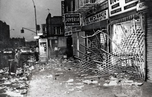 This is a scene along Utica Ave., in Brooklyn during New York City's electrical power outage on Thursday, July 14, 1977.  In one three-block length virtually every store had its windows smashed and its contents looted in the aftermath of the blackout July 13.