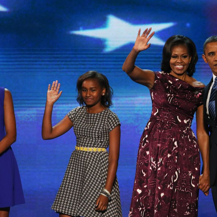 CHARLOTTE, NC - SEPTEMBER 06: Democratic presidential candidate, U.S. President Barack Obama stands on stage with (L-R) Malia Obama, Sasha Obama and First lady Michelle Obama after accepting the nomination during the final day of the Democratic National Convention at Time Warner Cable Arena on September 6, 2012 in Charlotte, North Carolina. The DNC, which concludes today, nominated U.S. President Barack Obama as the Democratic presidential candidate. (Photo by Alex Wong/Getty Images)