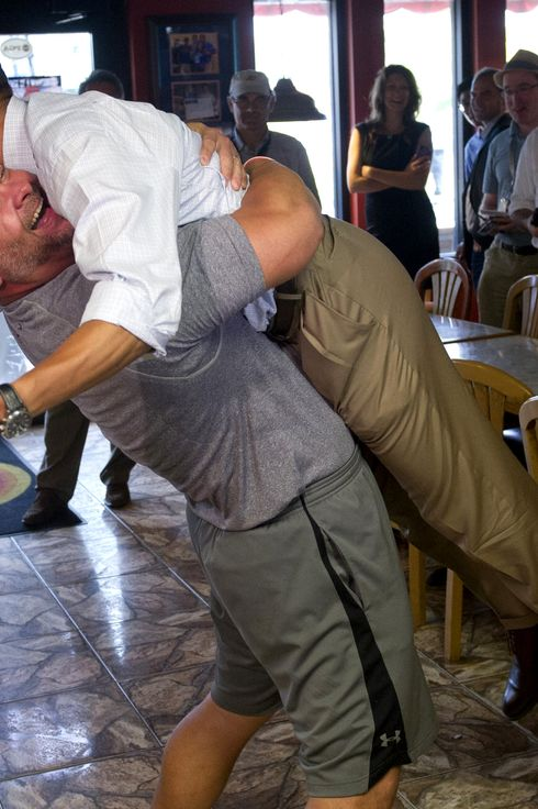 US President Barack Obama is picked up by Scott Van Duzer, owner of Big Apple Pizza and Pasta Italian Restaurant during a visit to the restaurant in Fort Pierce, Florida, September 9, 2012, during the second day of a 2-day bus tour across Florida. AFP PHOTO / Saul LOEB        (Photo credit should read SAUL LOEB/AFP/GettyImages)