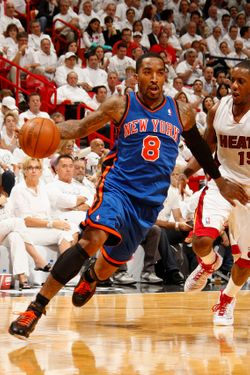MIAMI, FL - APRIL 30:  J.R. Smith #8 of the New York Knicks drives to the basket against Mario Chalmers #15 of the Miami Heat in Game Two of the Eastern Conference Quarterfinals during the 2012 NBA Playoffs on April 30, 2012 at American Airlines Arena in Miami, Florida. NOTE TO USER: User expressly acknowledges and agrees that, by downloading and or using this photograph, User is consenting to the terms and conditions of the Getty Images License Agreement. Mandatory Copyright Notice: Copyright 2012 NBAE  (Photo by Issac Baldizon/NBAE via Getty Images)