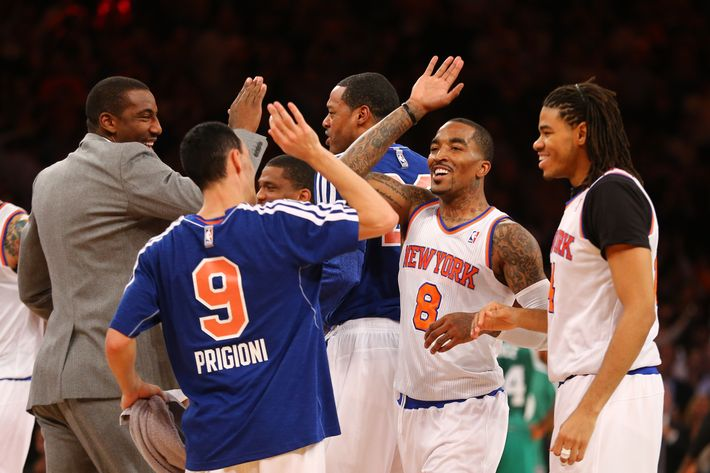 NEW YORK, NY - APRIL 23:  J.R. Smith #8 of the New York Knicks celebrates after hitting a three point shot to end the first quarter against the Boston Celtics during Game two of the Eastern Conference Quarterfinals of the 2013 NBA Playoffs at Madison Square Garden on April 23, 2013 in New York City.  NOTE TO USER: User expressly acknowledges and agrees that, by downloading and or using this photograph, User is consenting to the terms and conditions of the Getty Images License Agreement.  (Photo by Al Bello/Getty Images)