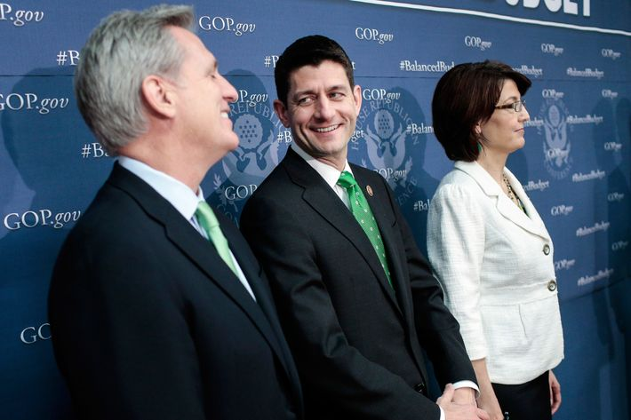 Rep. Paul Ryan (R-WI) (C) jokes with House Majority Whip Kevin McCarthy (R-CA) (L) as House Republican leaders, including House Republican Conference Chairman Cathy McMorris Rodgers (R-WA) address the media after a party conference on March 19, 2013 in Washington, DC. GOP leaders asked that the president work with them to create a balanced budget plan, citing President Clinton's efforts to work with House Republicans on a budget in the 1990s.