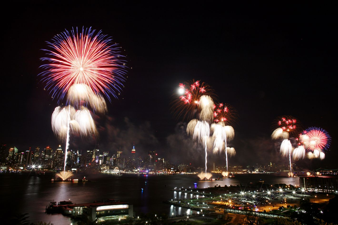 The New York City skyline is seen in the distance as fireworks explode over the Hudson River during the Macy's fireworks display July 4, 2009 in Weehawken, New Jersey.  It was the first time since 2000 that the Macy's display took place over the Hudson River and not the East River.