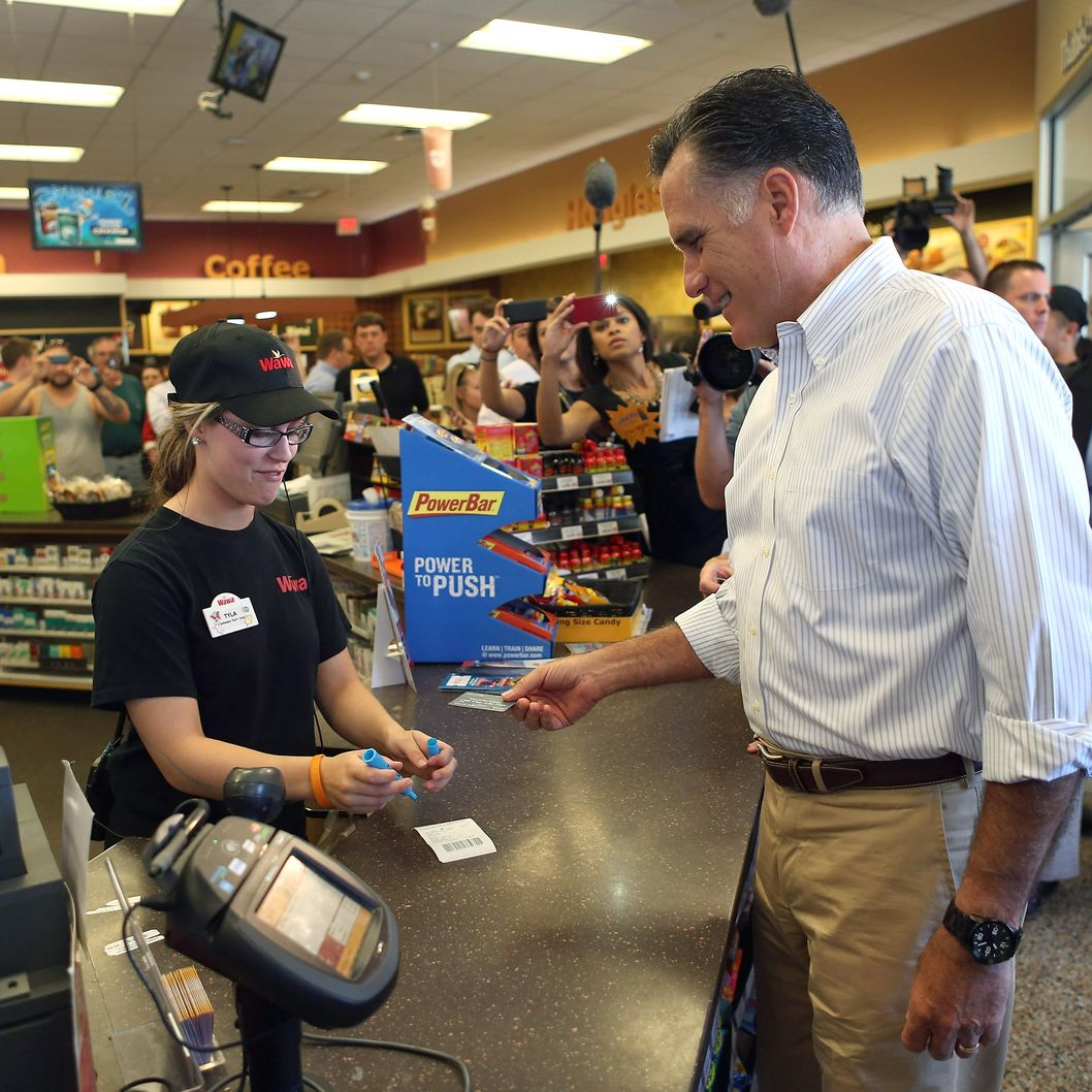 QUAKERTOWN, PA- JUNE 16:   Republican Presidential candidate, former Massachusetts Gov. Mitt Romney prepares to pay for a sandwich in a WaWa Gas Station on June 16, 2012 in Quakertown, Pennsylvania.  Mr. Romney continues hs campaign swing through battle ground states as he battles President Barack Obama for votes.  (Photo by Joe Raedle/Getty Images)