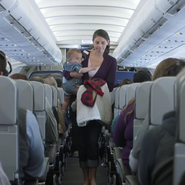 A mother and child, on an airplane