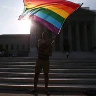 Gay rights activist Vin Testa of DC, waves a flag in front of the U.S. Supreme Court building, June 26, 2013 in Washington DC. Today the high court is expected to rule on California's Proposition 8, the controversial ballot initiative that defines marriage as between a man and a woman