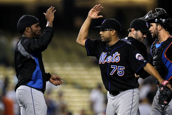 LOS ANGELES, CA - JULY 06:  Closer Francisco Rodriguez #75 and Jose Reyes #7 of the New York Mets celebrate after Rodriguez picked up a save against the Los Angeles Dodgers on July 6, 2011 at Dodger Stadium in Los Angeles, California.  The Mets won 5-3.  (Photo by Stephen Dunn/Getty Images)