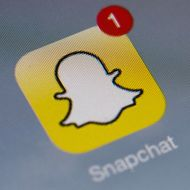 "The logo of mobile app ""Snapchat"" is displayed on a tablet on January 2, 2014 in Paris. Hackers broke into Snapchat, the hugely popular mobile app, accessing the phone numbers and usernames of 4.6 million users and publishing them online, tech news website TechCrunch has announced."
