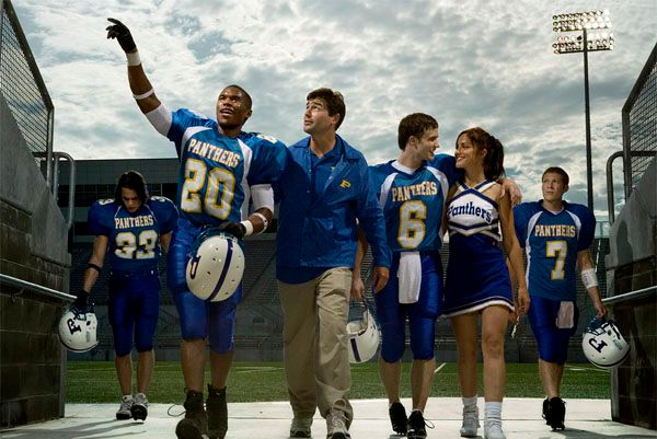 "FRIDAY NIGHT LIGHTS -- Pictured: (l-r) Taylor Kitsch as Tim Riggins, Gaius Charles as Brian ""Smash"" Williams, Kyle Chandler as Eric Taylor, Scott Porter as Jason Street, Minka Kelly as Lyla"