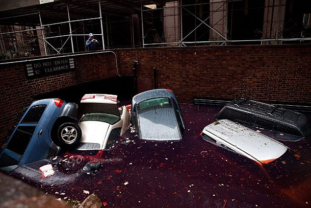 NEW YORK, NY - OCTOBER 30:  Cars floating in a flooded subterranian basement following Hurricaine Sandy on October 30, 2012 in the Financial District of New York, United States. The storm has claimed at least 16 lives in the United States, and has caused massive flooding across much of the Atlantic seaboard. US President Barack Obama has declared the situation a 'major disaster' for large areas of the US East Coast including New York City. (Photo by Andrew Burton/Getty Images)