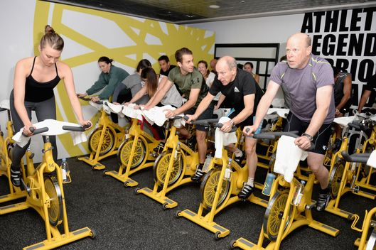Guests attend BELLA Juice Bar at The Soul Cycle Lounge on January 17, 2014 in Park City, Utah.