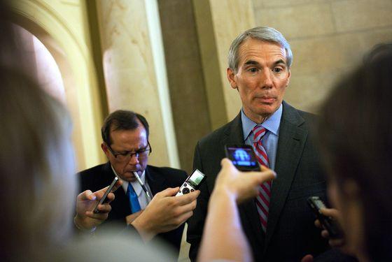 "Senator Rob Portman (R-OH) speaks with reporters outside of Speaker John Boehner's office, on Capitol Hill, December 20, 2012 in Washington, DC. House Republicans called off plans to vote on Boehner's ""Plan B"" Fiscal Cliff plan."