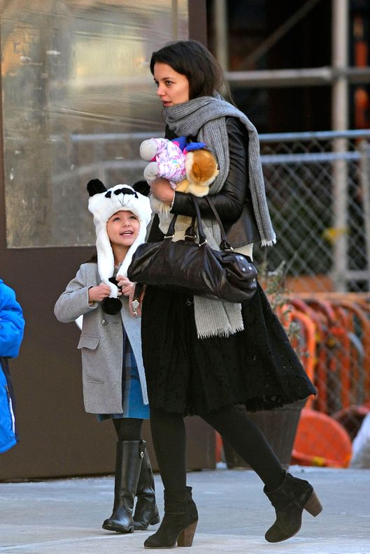 Suri Cruise wears a panda winter hat while coming with mom, Katie Holmes, out of Locanda Verde restaurant at the Greenwhich Hotel after attending a kid's party with playmates. Pictured: Katie Holmes and Suri Cruise