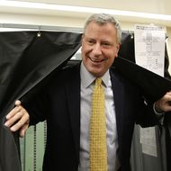 NEW YORK, NY - SEPTEMBER 10:  Public Advocate and mayoral candidate Bill de Blasio emerges from a voting booth after voting in the New York City mayoral primary on September 10, 2013 in the Brooklyn borough of New York City. In recent polls by Quinnipiac University, de Blasio is now close to the 40 percent threshold he'd need to avoid a runoff in the Democratic primary.  (Photo by Spencer Platt/Getty Images)