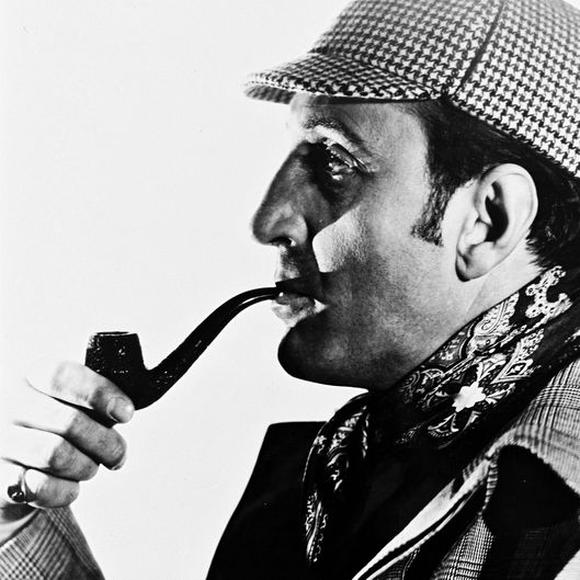 Basil Rathbone (1892-1967), British actor, wearing a deerstalker hat and smoking a pipe, in profile, in a studio portrait, against a white background, circa 1945. Rathbone played the character of 'Sherlock Holmes', created by Sir Arthur Conan Doyle (1859-1930), in a series of fourteen films. (Photo by Silver Screen Collection/Getty Images)