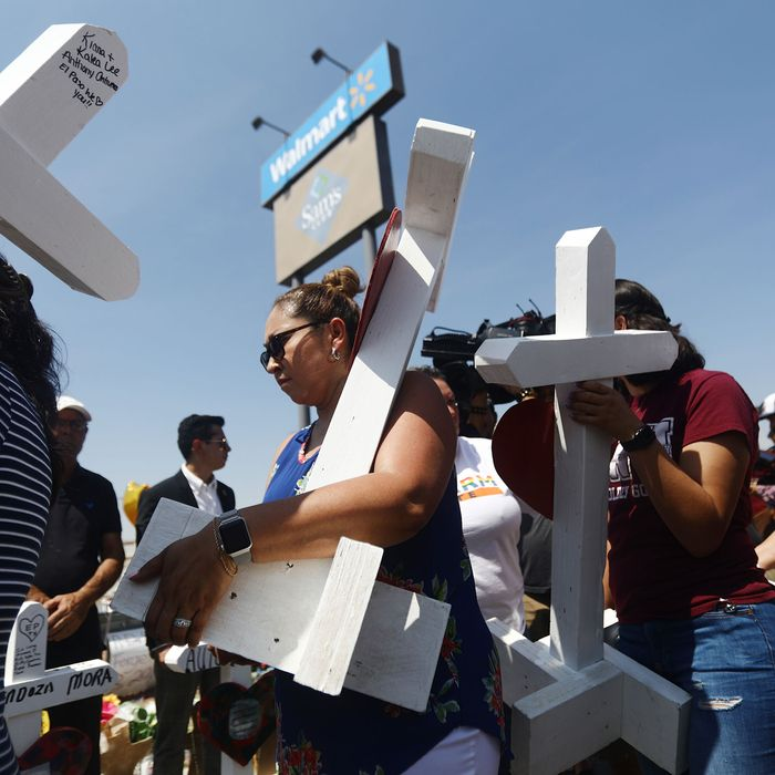 Mourners in El Paso, Texas, after a mass shooting there killed 22 people in August 2019.