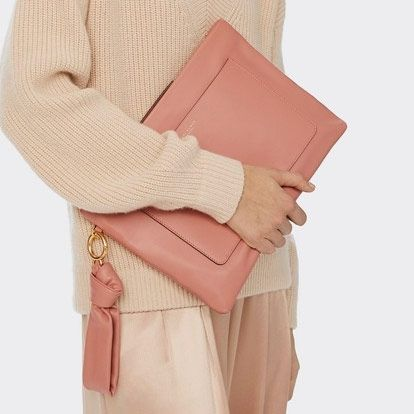 tory burch peach color hand carry pouch
