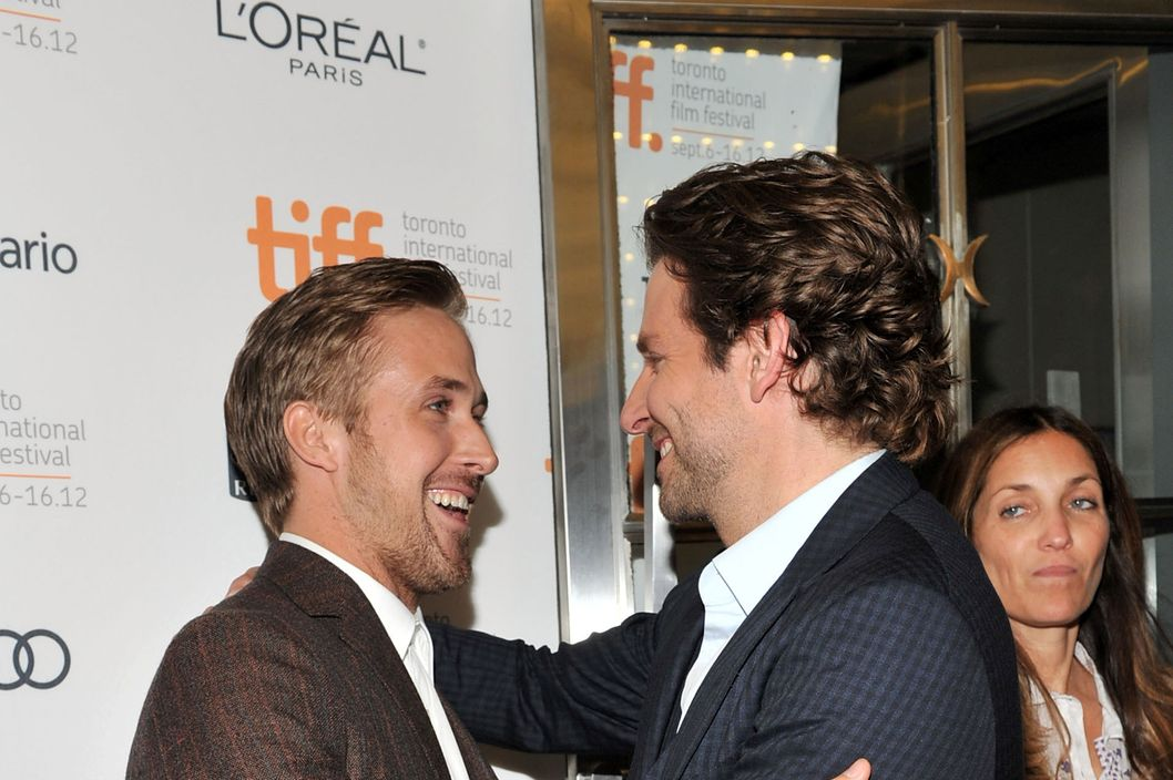 "TORONTO, ON - SEPTEMBER 07: Actors (L-R) Ryan Gosling and Bradley Cooper attend ""The Place Beyond The Pines"" premiere during the 2012 Toronto International Film Festival at Princess of Wales Theatre on September 7, 2012 in Toronto, Canada.  (Photo by Sonia Recchia/Getty Images)"
