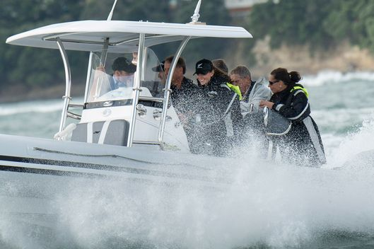 Catherine, Duchess of Cambridge and Prince William, Duke of Cambridge on board 'Sealegs' in Auckland Harbour on April 11, 2014 in Auckland, New Zealand. The Duke and Duchess of Cambridge are on a three-week tour of Australia and New Zealand, the first official trip overseas with their son, Prince George of Cambridge.