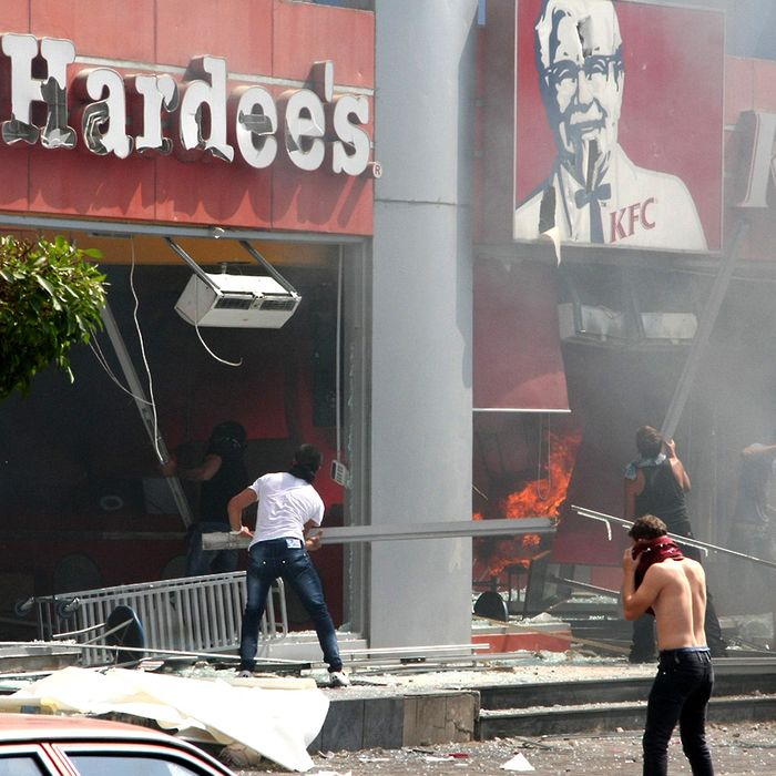 Lebanese men ransack US fast food chains Hardee's and KFC as they protest against the controversial film