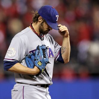ST LOUIS, MO - OCTOBER 28: C.J. Wilson #36 of the Texas Rangers stands on the mound in the sixth inning during Game Seven of the MLB World Series against the St. Louis Cardinals at Busch Stadium on October 28, 2011 in St Louis, Missouri. (Photo by Ezra Shaw/Getty Images)