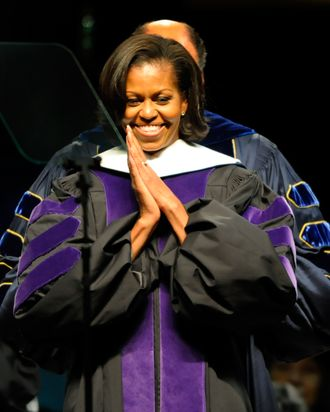 GREENSBORO, NC - MAY 12: U.S. First Lady Michelle Obama is hooded for her Doctorate in Humanities by Chancellor Harold Martin at the North Carolina Agricultural and Technical State University (NCA&T) Commencement May 12, 2012, in Greensboro, NC. Michelle Obama gave the commencement address. (Photo by Sara D. Davis/Getty Images)