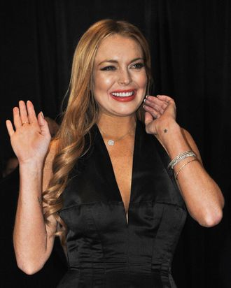 Actress Lindsay Lohan arrives at the annual White House Correspondents' Association dinner in Washington on April 27, 2012.