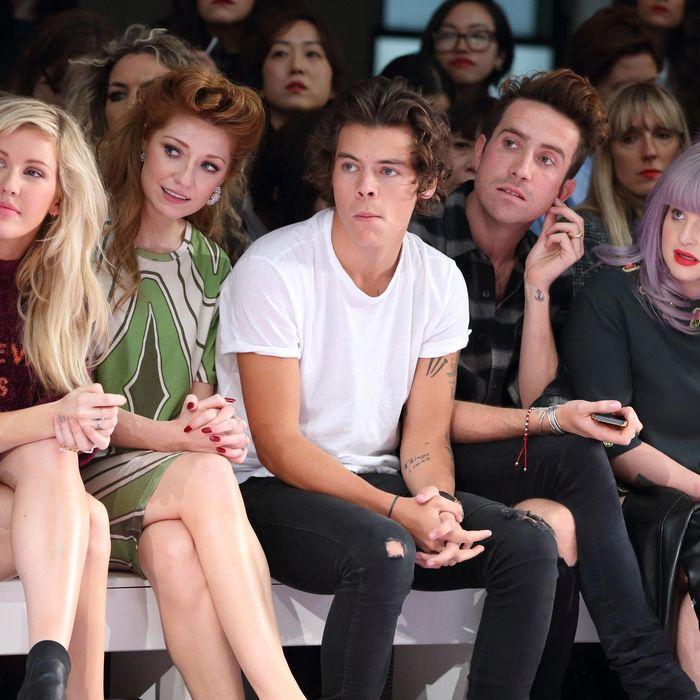 Harry Styles, mid-chew.
