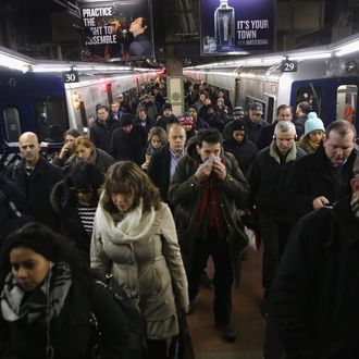Commuters arrive to Grand Central station from a Metro North train on January 22, 2014 in New York City. Snow and single digit temperatures made the morning difficult for New Yorkers and commuters alike.