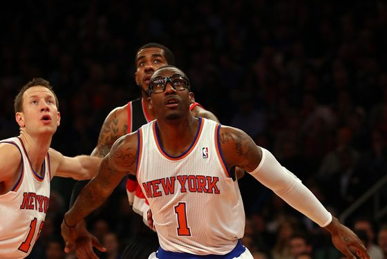 Amar'e Stoudemire #1 of the New York Knicks blocks out LaMarcus Aldridge #12 of the Portland Trail Blazers during a free throw shot in the first half on January 1, 2013 at Madison Square Garden in New York City.