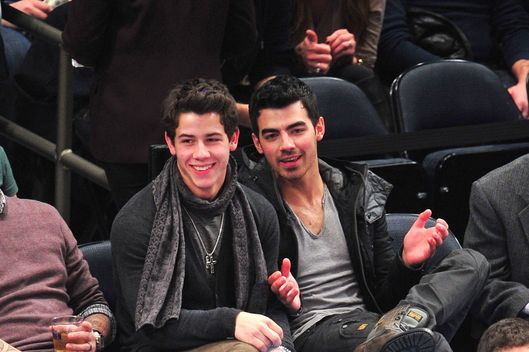 NEW YORK, NY - JANUARY 21:  Nick Jonas and Joe Jonas attend the Denver Nuggets vs New York Knicks game at Madison Square Garden on January 21, 2012 in New York City.  (Photo by James Devaney/WireImage)