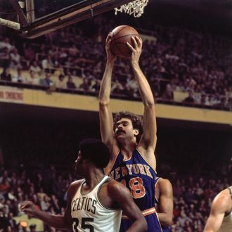 Phil Jackson #19 of the New York Knicks rebounds against Paul Silas #35 of the Boston Celtics during a game played in 1973 at the Boston Garden in Boston, Massachusetts.